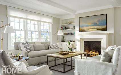 To fulfill the owners' request for a light-filled home with a traditional yet casual feel, designer Emily Pinney chose a natural palette that echoes the subtle hues of the nearby water, exemplified in the living room's furniture and accessories.