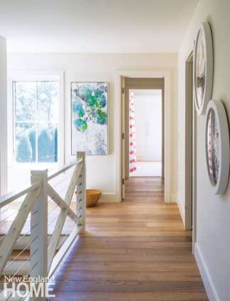 Windows and an open, modern balustrade keep the upstairs hallway as bright as the rest of the house.