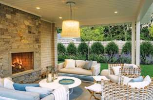 The pool is adjacent to the outdoor dining area. The covered outdoor living room with much-loved fireplace is part of the cabana area.