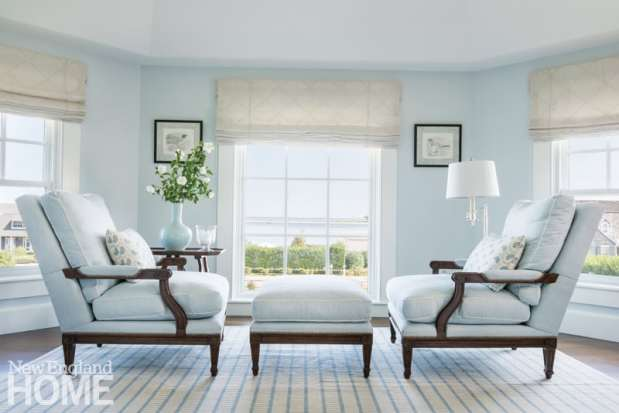 Louis XV chairs frame the view from the master suite's sitting area, which looks due east over Chatham Harbor and North Beach Island.