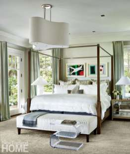 Master bedroom with mirrored nightstands