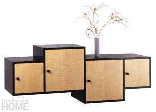 ared wall-mounted cabinet in curly maple and ebonized ash.