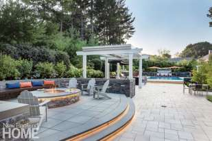A raised terrace with a fire pit is a fine setting for evening entertaining.