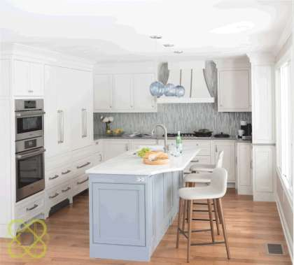 A comprehensive kitchen renovation reconfigured the space for flow and efficiency while beautiful cabinetry and materials selected by the design team resulted in a light and airy cooking and gathering space.