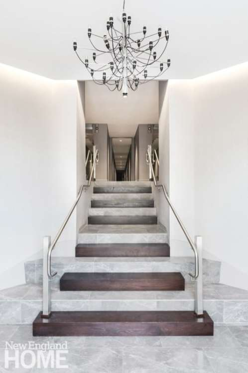 The minimalist staircase welcomes people to The Lucas, a church converted into a condominium building in Boston's South End.