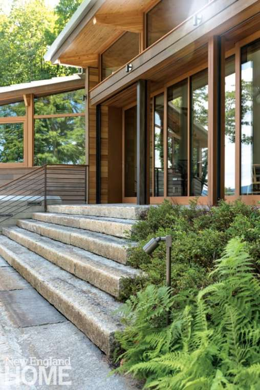 Reclaimed granite and native plantings complement the natural materials used in the contemporary home's construction.
