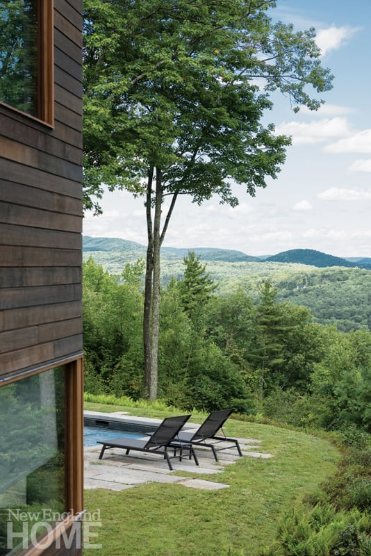 The home's energy-efficient triple-pane windows glimpse the forested mountains at every opportunity.