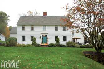 Colonial home with fall decor
