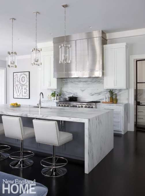 Kitchen with crystal pendants and stainless steel