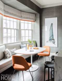 Banquette with orange chairs