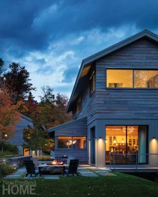Exterior Stowe, Vermont home designed by Michele Foster at night