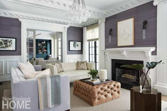 Working with Boston's Krakow Witkin Gallery and Jules Place, the designer and her clients found contemporary art that beautifully complements the old room. In the same congenial spirit, modern furnishings and fixtures look right at home with the living room's classic architectural details.