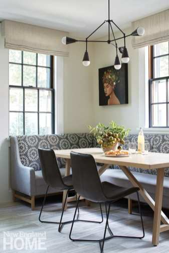 The kitchen's dining area sports an arresting acrylic on panel by Duy Huynh and a contemporary Apparatus chandelier in blackened brass.