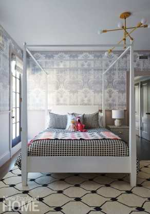 As stylish as any grown-up haven, the little girl's room holds an Ethan Allen bed from the owners' previous home, which Irving refreshed with a coat of white paint. A geometric Tibetan wool rug and CB2 bedding strike additional notes of sophistication.