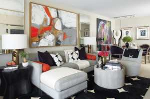 The dining room of a Stamford, Connecticut, apartment features shades of gray, black, white and orange.