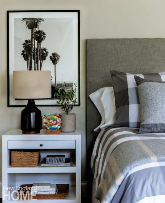 Guest bedroom with gray bed and a black and white photo of palm trees