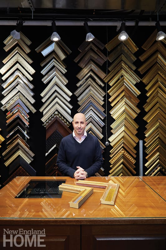 Eric Mauskopf standing in front of picture frames at his shop, J Pocker