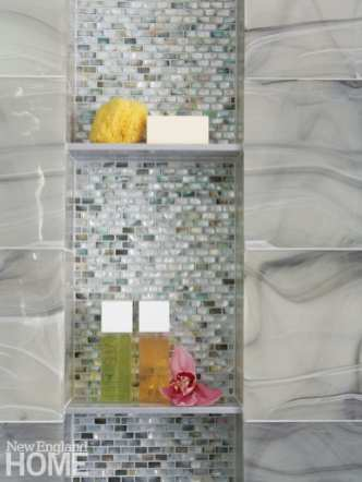 The interior of a shower with a silver mosaic tile wall