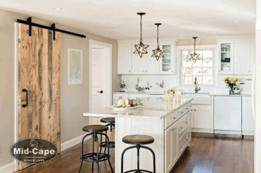 Mid-Cape Home Centers Kitchen with a distressed barn door