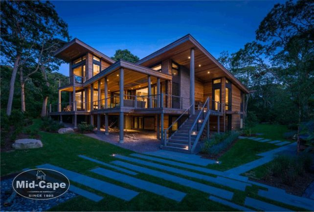 Mid-Cape Home Centers A modern home lit from the inside at dusk