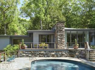 The back of the house and the edge of a sunken swimming pool