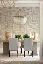 Dining room with chandelier over table and green hydrangeas on table