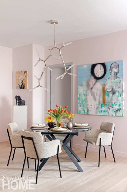 Dining room with pale pink walls and a round dining room table. The stilettos are in the corner.