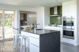 Forgoing upper cabinets keeps the kitchen sleek; the architects added a second pantry for storage.