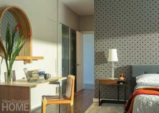 A mirror from the North Carolina furniture company Skram is a curvy foil to the master bedroom's sleek Giorgetti desk.