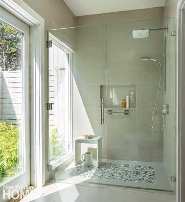 The master bath opens onto an outdoor shower planted with bamboo.