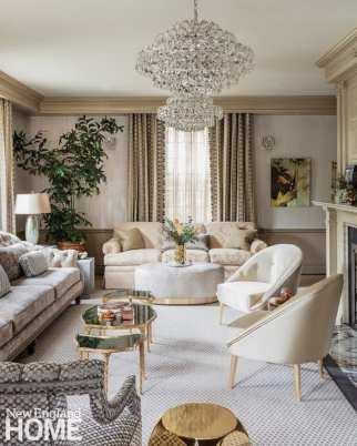 Another view of the living room with a glass chandelier hanging from the ceiling.