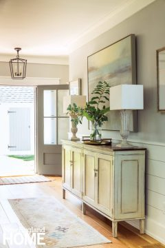 a pale yellow accent table in an entryway