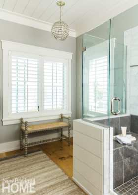 master bathroom with a separate shower and a bench under a window