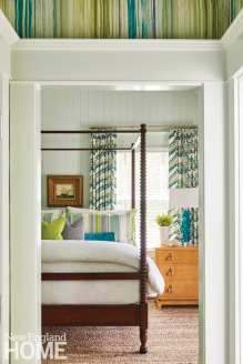 8a9612323429 master bedroom with dark wood canopy bed and pale green shiplap walls