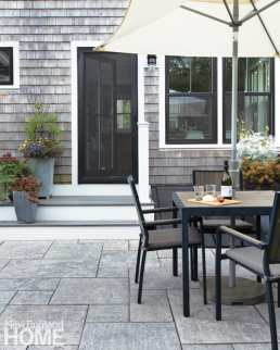The back patio has gray stone tiles for continuity with the look and feel of the kitchen floor.