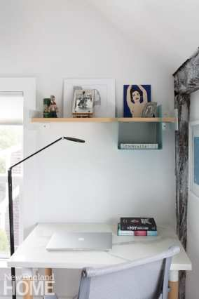 Another guest room, which doubles as an office, has a desk cleverly composed of leftover marble from the kitchen counter atop legs from IKEA.