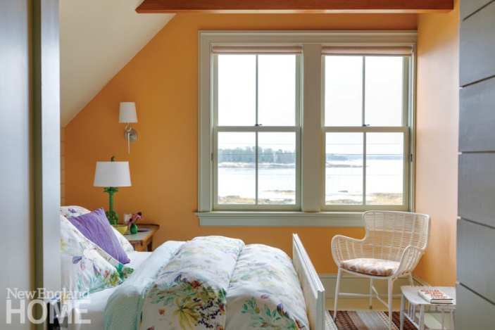 bedroom with water views and orange walls