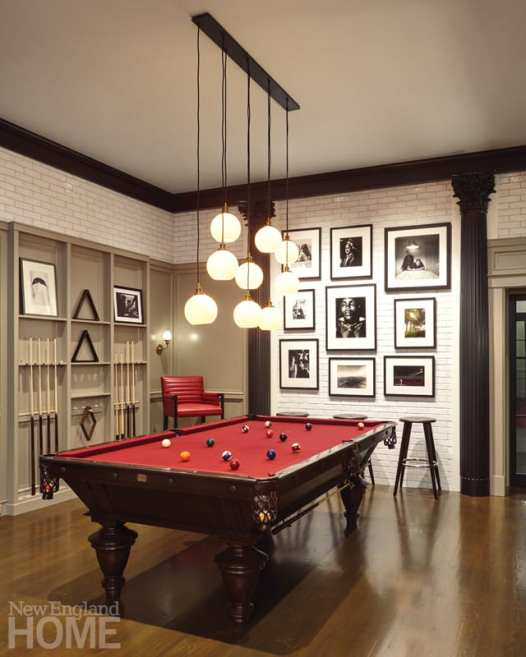 The billiards room is on the lower level—a space dedicated to entertaining and fun and outfitted in sumptuous reds and black.
