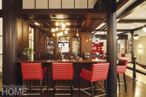 Quilted barstools make for comfortable seating at the lower-level bar.
