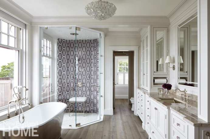 The shower's Bisazza tile wall adds a bold touch to the wife's serene bathroom.