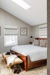 a newport vacation home's master bedroom with striped wallcovering