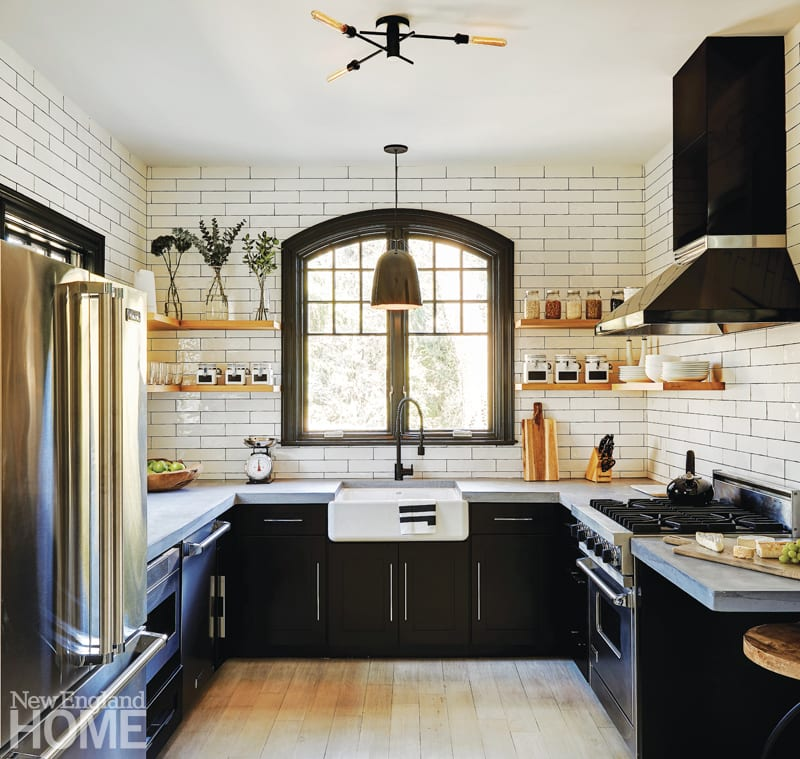 New England Home Connecticut ten years subway tiles and black cabinets
