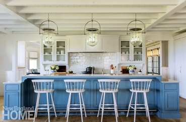 Large coastal kitchen with a bright blue island