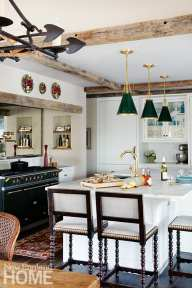 Traditional white kitchen with green pendant lights