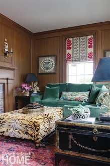 Study with green sofa and animal print ottoman