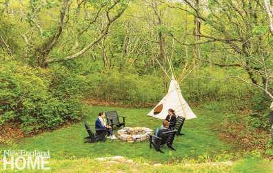 A clearing is the perfect spot for a firepit and wigwam.