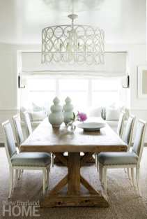 Family dinners take place around a sturdy farmhouse table in the light-washed dining room.