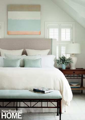 Interior shutters allow for calibrating light in the master bedroom.