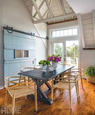 Dining area with light blue barn door.