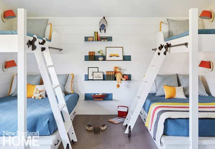 bunk room with white walls and blue bedding